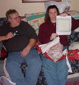 Ellen opening her Christmas present