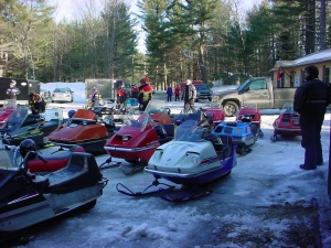 The gathering of snowmobiles at the club house.